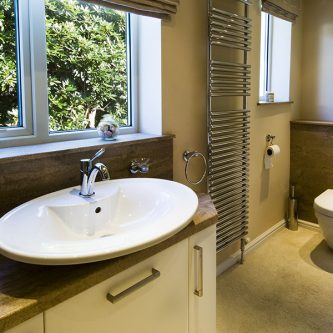 Vanity Top, Bathroom Wall Panels and Splashback in Sandstone Granite Finish