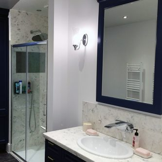 Vanity Top, Shower Panels and Shower Enclosure in Arabesque Marble Finish