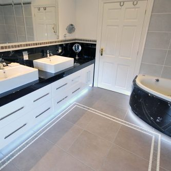 Vanity Top, Splashback and Bath Front Panel in Norvein Marble Finish