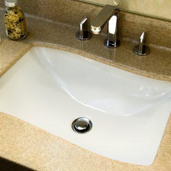 Vanity Top in Almond Granite Finish and Splashback in Botticcino Marble Finish