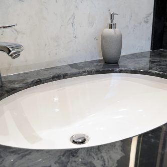 Vanity top in Gloucester Marble Finish and Wall Panels and Splasback in Arabesque Marble Finish