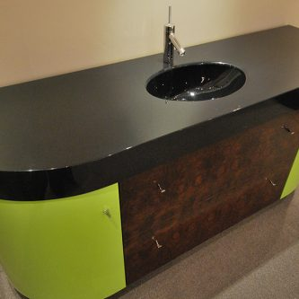 Vanity Top With an Integral Bowl in Noire Gun Metal Granite Finish
