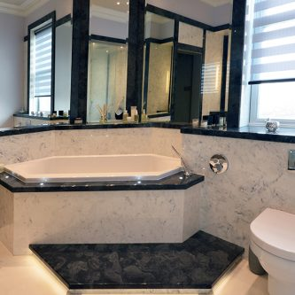 Wall Panels, Bath Front and Floor Slabs in Arabesque Marble Finish and Bath Deck and Step in Glouchester Marble Finish