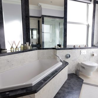 Wall Panels, Shower Panels and Floor Slab in Arabesque Marble Finish and Vanity Top and Decorative Wall Panels in Glouchester Marble Finish