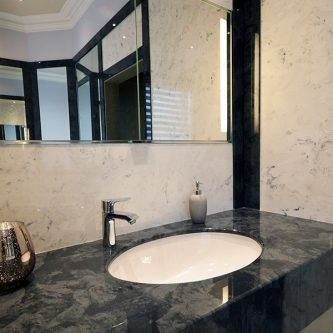 Wall Panels in Arabesque Marble Finish and Vanity Top and Decorative Panels in Glouchester Marble Finish