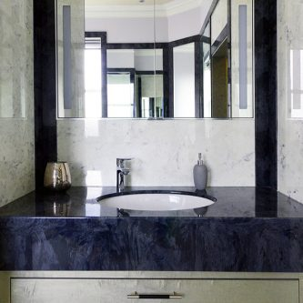 Wall Panels in Arabesque Marble Finish and Vanity Top in Glouchester Marble Finish