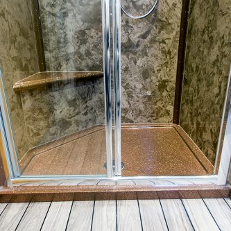 Wall and Shower Panels in Coffee Cream Marble Finish and Shower Tray and Decorative Panels in Coco-Loco Reflect Finish