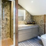 Bathroom design featuring an undermounted villeroy and boch sink keuco mirror cabinet and a geberit toilet