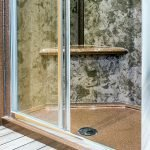 Made-to-measure-shower-enclosure-with-a-sparkly-shower-tray-and-coffe-and-cream-wall-panels-both-from-versital